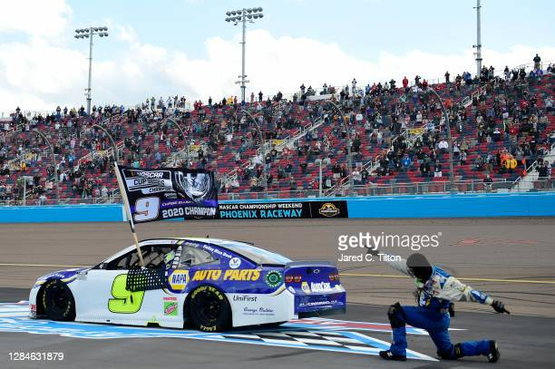Chase Elliott, driver of the NAPA Auto Parts Chevrolet, and pit crew member celebrate after winning the NASCAR Cup Series Season Finale 500 and the...