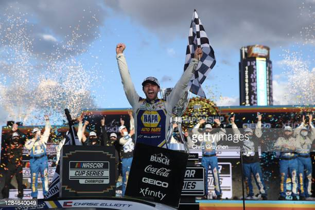 Chase Elliott, driver of the NAPA Auto Parts Chevrolet, celebrates in victory lane after winning the NASCAR Cup Series Season Finale 500 and the 2020...