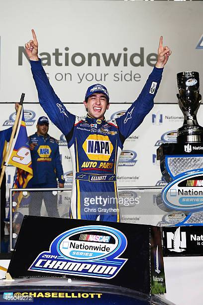 Chase Elliott driver of the NAPA Auto Parts Chevrolet celebrates in Victory Lane after winning the series championship during the NASCAR Nationwide...