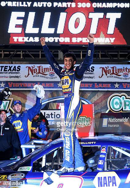 Chase Elliott, driver of the NAPA Auto Parts Chevrolet, celebrates in victory lane after winning the NASCAR Nationwide Series O'Reilly Auto Parts 300...