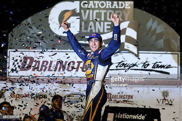 Chase Elliott driver of the NAPA Auto Parts Chevrolet celebrates in Victory Lane after winning the NASCAR Nationwide Series VFW Sport Clips Help A...