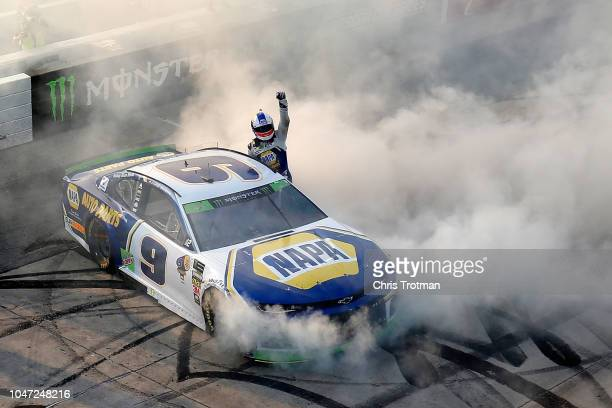 Chase Elliott driver of the NAPA Auto Parts Chevrolet celebrates winning the Monster Energy NASCAR Cup Series Gander Outdoors 400 at Dover...