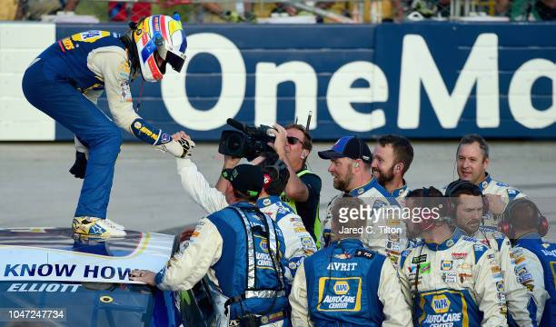 Chase Elliott driver of the NAPA Auto Parts Chevrolet celebrates with his team after winning the Monster Energy NASCAR Cup Series Gander Outdoors 400...