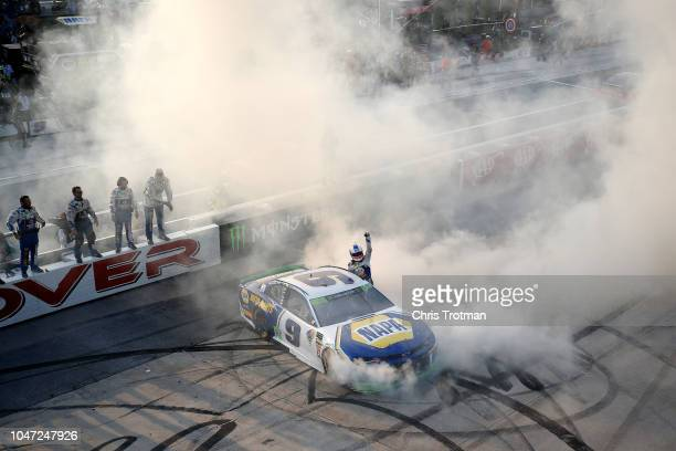 Chase Elliott driver of the NAPA Auto Parts Chevrolet celebrates with a burnout after winning the Monster Energy NASCAR Cup Series Gander Outdoors...