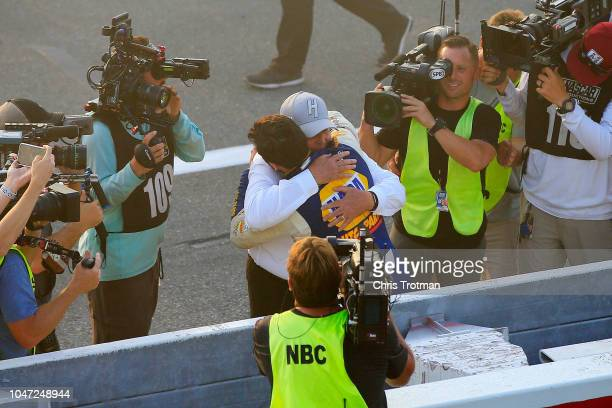 Chase Elliott driver of the NAPA Auto Parts Chevrolet celebrates with team owner and NASCAR Hall of Famer Rick Hendrick after winning the Monster...