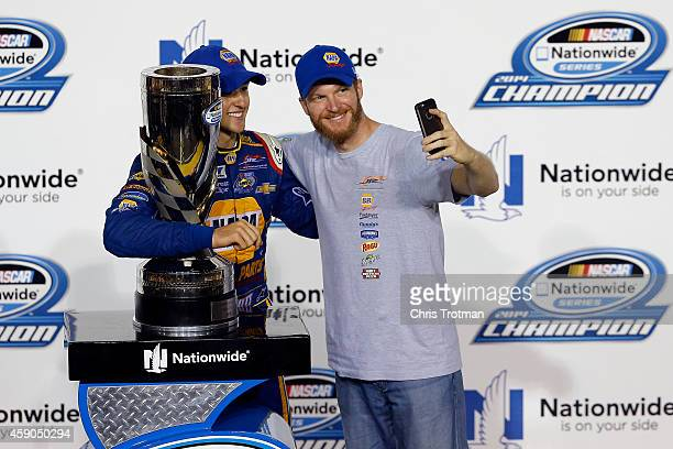 Chase Elliott, driver of the NAPA Auto Parts Chevrolet, celebrates with the trophy in Victory Lane with team owner Dale Earnhardt jr. After winning...