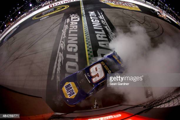 Chase Elliott driver of the NAPA Auto Parts Chevrolet celebrates with a burnout after winning the NASCAR Nationwide Series VFW Sport Clips Help A...