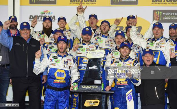 Chase Elliott driver of the NAPA Auto Parts Chevrolet celebrates with crew members and team owner Rick Hendrick in Victory Lane after winning the...