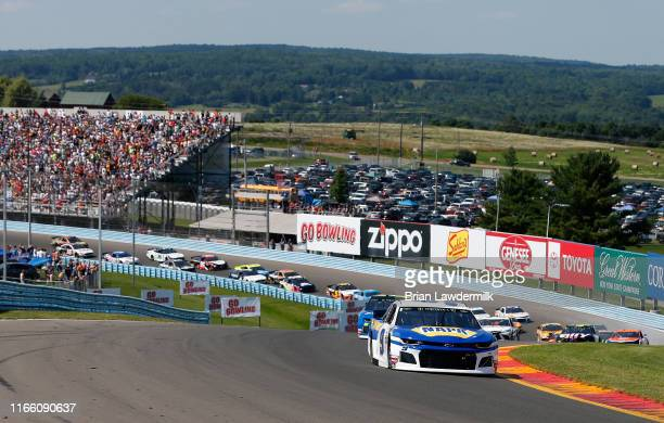 Chase Elliott, driver of the NAPA AUTO PARTS Chevrolet, leads a pack of cars during the Monster Energy NASCAR Cup Series Go Bowling at The Glen at...