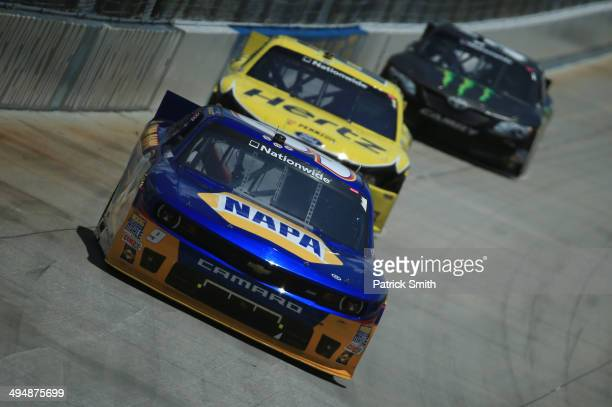 Chase Elliott driver of the NAPA Auto Parts Chevrolet leads Joey Logano driver of the Hertz Ford during the NASCAR Nationwide Series Buckle Up 200...