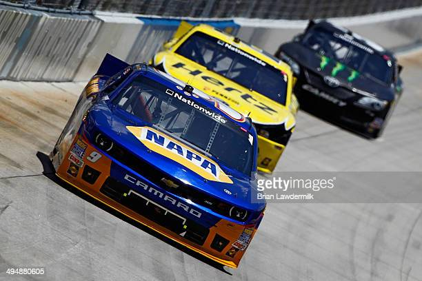 Chase Elliott driver of the NAPA Auto Parts Chevrolet leads Joey Logano driver of the Hertz Ford and Kyle Busch driver of the Monster Energy Toyota...