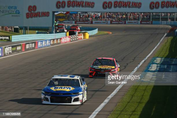 Chase Elliott, driver of the NAPA AUTO PARTS Chevrolet, leads Martin Truex Jr, driver of the Bass Pro Shops Toyota, during the Monster Energy NASCAR...
