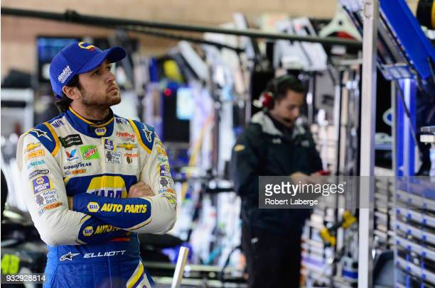 Chase Elliott driver of the NAPA Auto Parts Chevrolet looks on during qualifying for the Monster Energy NASCAR Cup Series Auto Club 400 at Auto Club...
