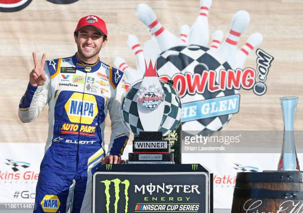 Chase Elliott, driver of the NAPA AUTO PARTS Chevrolet, poses with the trophy after winning the Monster Energy NASCAR Cup Series Go Bowling at The...
