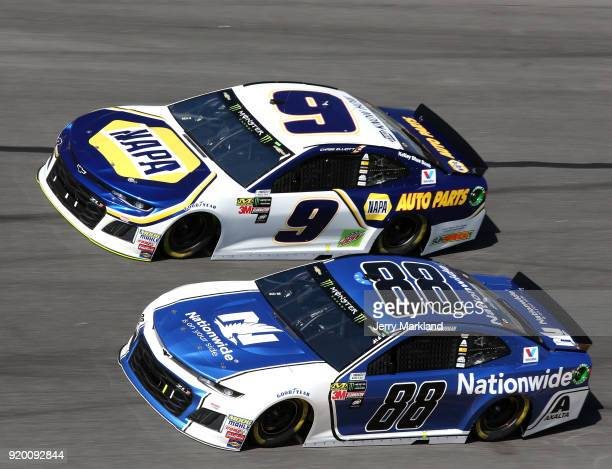 Chase Elliott driver of the NAPA Auto Parts Chevrolet races Alex Bowman driver of the Nationwide Chevrolet during the Monster Energy NASCAR Cup...