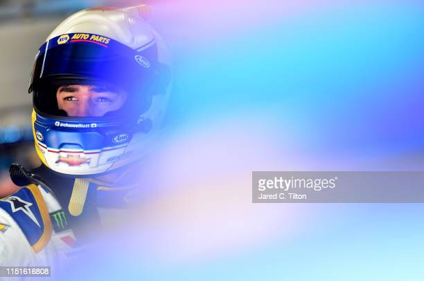 Chase Elliott driver of the NAPA Auto Parts Chevrolet stands in the garage area during practice for the Monster Energy NASCAR Cup Series CocaCola 600...