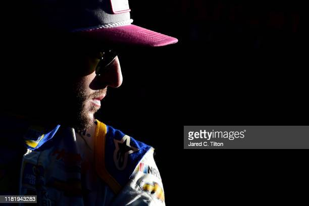 Chase Elliott driver of the NAPA Auto Parts Chevrolet stands in the garage area during practice for the Monster Energy NASCAR Cup Series Hollywood...