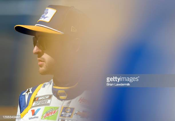 Chase Elliott driver of the NAPA Auto Parts Chevrolet stands on the grid during qualifying for the NASCAR Cup Series 62nd Annual Daytona 500 at...