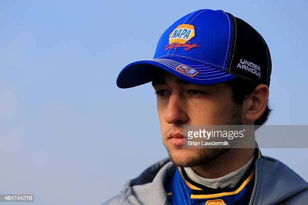 Chase Elliott driver of the NAPA Auto Parts Chevrolet stands on the grid during qualifying for the NASCAR XFINITY Series Hisense 250 at Atlanta Motor...