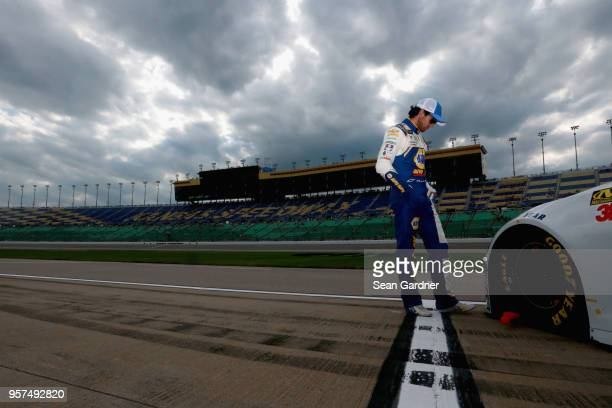 Chase Elliott driver of the NAPA Auto Parts Chevrolet stands on the grid during qualifying for the Monster Energy NASCAR Cup Series KC Masterpiece...