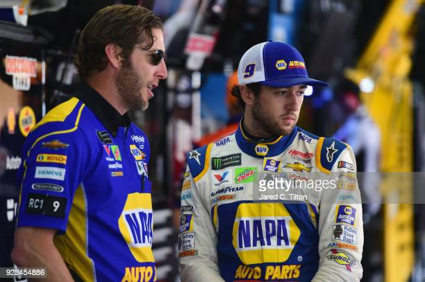 Chase Elliott driver of the NAPA Auto Parts Chevrolet stands with his crew chief Alan Gustafson in the garage area during practice for the Monster...