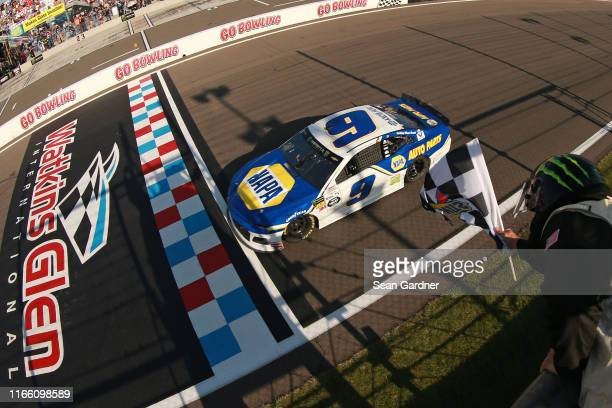 Chase Elliott, driver of the NAPA AUTO PARTS Chevrolet, takes the checkered flag to win the Monster Energy NASCAR Cup Series Go Bowling at The Glen...