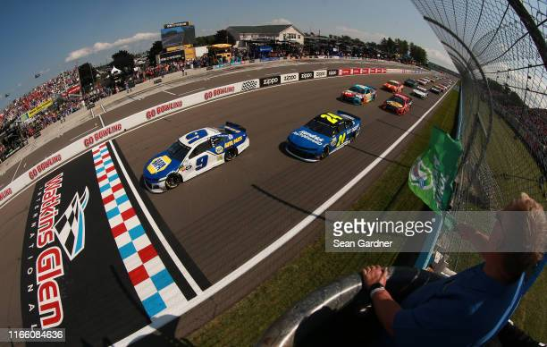 Chase Elliott driver of the NAPA AUTO PARTS Chevrolet takes the green flag to start the Monster Energy NASCAR Cup Series Go Bowling at The Glen at...