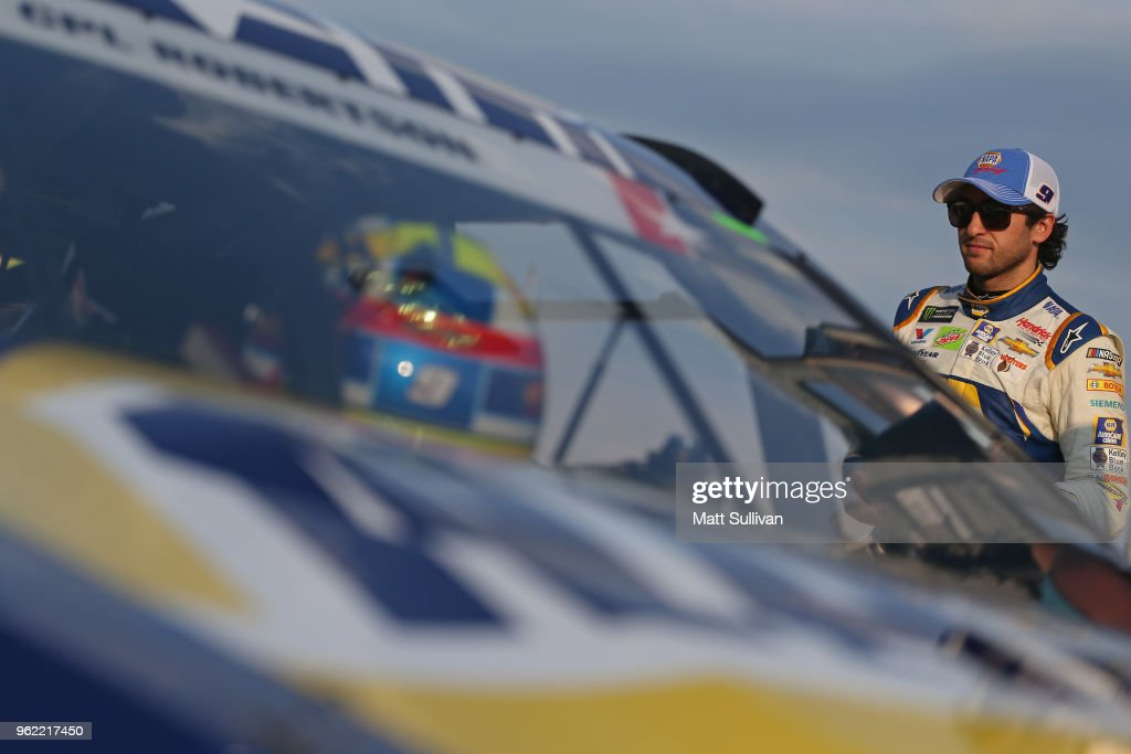 Chase Elliott, driver of the #9 NAPA Auto Parts Patriotic Chevrolet, stands by his car during qualifying for the Monster Energy NASCAR Cup Series Coca-Cola 600 at Charlotte Motor Speedway on May 24, 2018 in Charlotte, North Carolina.