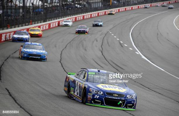 Chase Elliott driver of the NAPA Brakes Chevrolet leads a pack of cars during the Monster Energy NASCAR Cup Series Tales of the Turtles 400 at...
