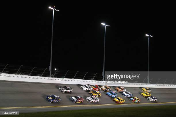 Chase Elliott driver of the NAPA Chevrolet leads a pack of cars during the Monster Energy NASCAR Cup Series CanAm Duel 1 at Daytona International...