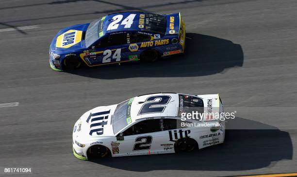 Chase Elliott driver of the NAPA Chevrolet leads Brad Keselowski driver of the Miller Lite Ford during the Monster Energy NASCAR Cup Series Alabama...