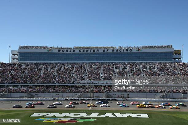 Chase Elliott driver of the NAPA Chevrolet leads the field past the green flag to start the 59th Annual DAYTONA 500 at Daytona International Speedway...