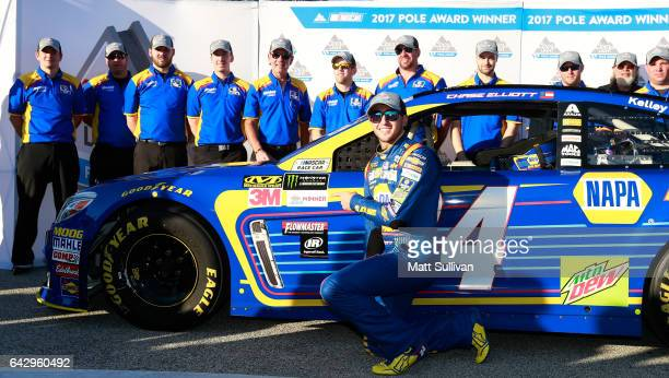 Chase Elliott driver of the NAPA Chevrolet poses with the Coors Light Pole Award after qualifying for pole position for the Monster Energy NASCAR Cup...