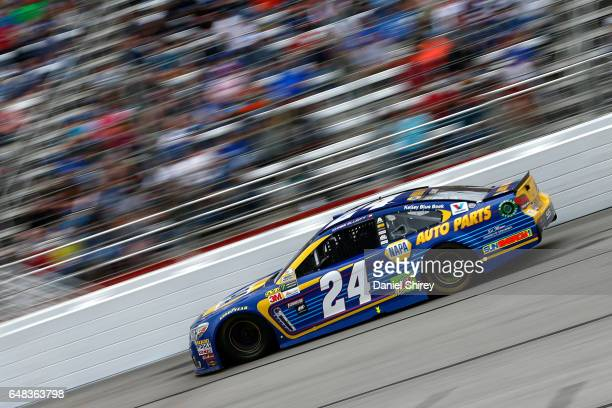 Chase Elliott driver of the NAPA Chevrolet races during the Monster Energy NASCAR Cup Series Folds Of Honor QuikTrip 500 at Atlanta Motor Speedway on...