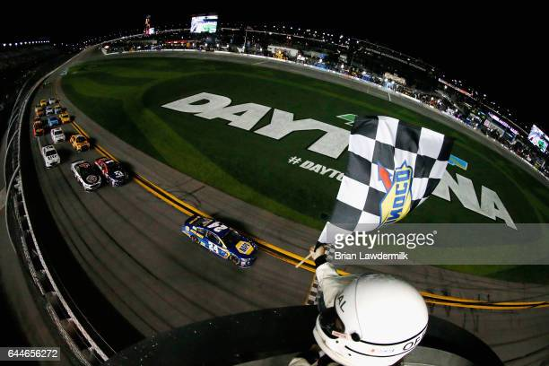 Chase Elliott driver of the NAPA Chevrolet takes the checkered flag to win the Monster Energy NASCAR Cup Series CanAm Duel 1 at Daytona International...