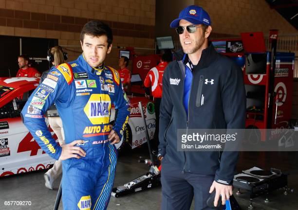 Chase Elliott driver of the NAPA Chevrolet talks with crew chief Alan Gustafson during practice for the Monster Energy NASCAR Cup Series Auto Club...
