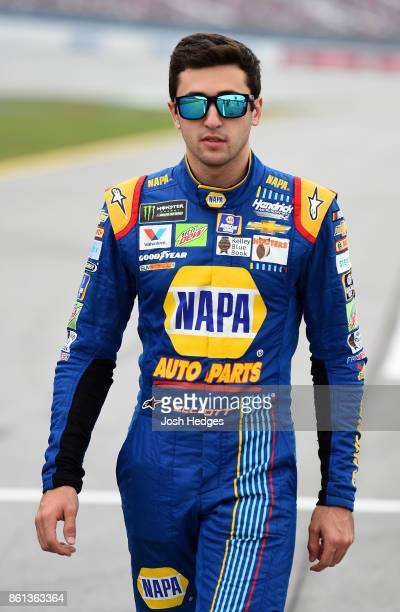 Chase Elliott driver of the NAPA Chevrolet walks on the grid during qualifying for the Monster Energy NASCAR Cup Series Alabama 500 at Talladega...