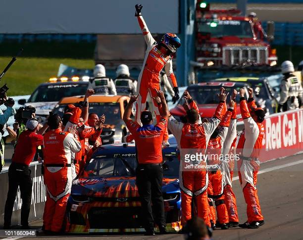 Chase Elliott, driver of the SunEnergy1 Chevrolet, celebrates after winning the Monster Energy NASCAR Cup Series GoBowling at The Glen at Watkins...