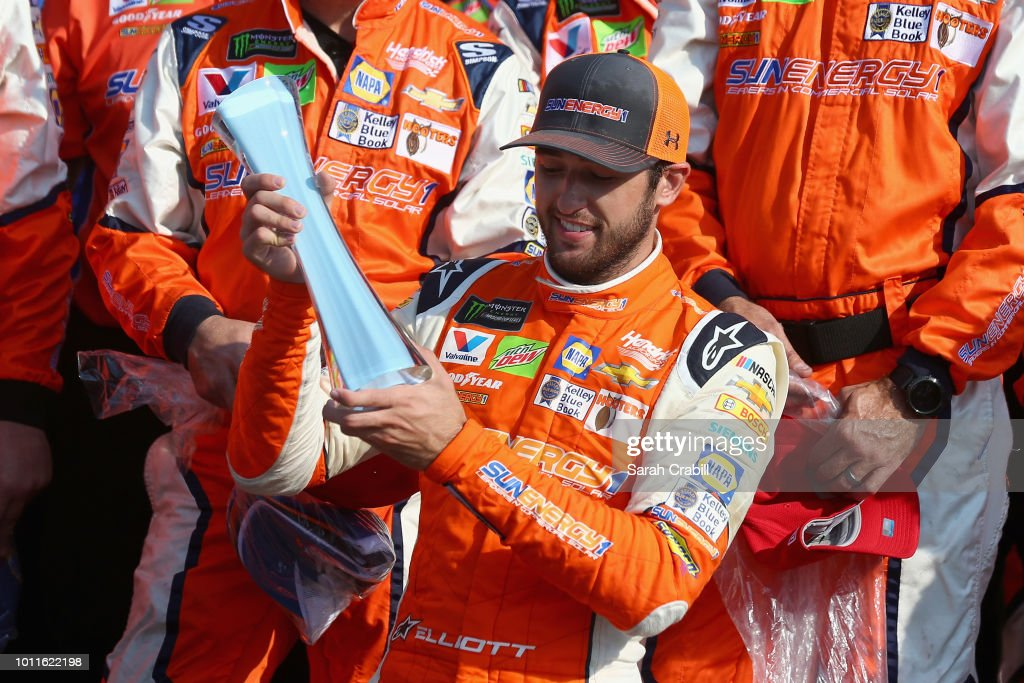 Chase Elliott, driver of the #9 SunEnergy1 Chevrolet, celebrates in Victory Lane after winning the Monster Energy NASCAR Cup Series GoBowling at The Glen at Watkins Glen International on August 5, 2018 in Watkins Glen, New York.