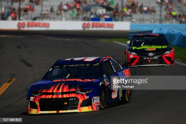 Chase Elliott driver of the SunEnergy1 Chevrolet leads Martin Truex Jr driver of the 5hour ENERGY/Bass Pro Shops Toyota during the Monster Energy...