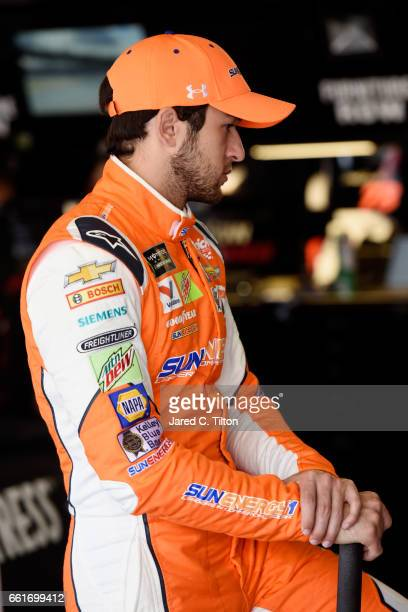 Chase Elliott driver of the SunEnergy1 Chevrolet looks on from the garage during practice for the Monster Energy NASCAR Cup Series STP 500 at...