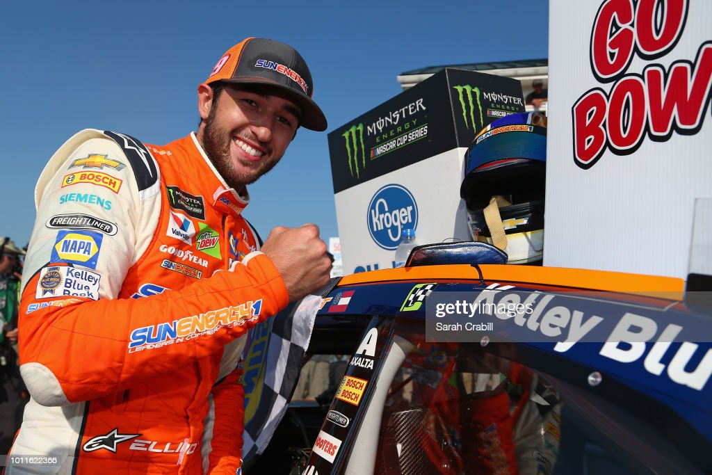 Chase Elliott, driver of the #9 SunEnergy1 Chevrolet, poses with the winner's decal on his car in Victory Lane after winning the Monster Energy NASCAR Cup Series GoBowling at The Glen at Watkins Glen International on August 5, 2018 in Watkins Glen, New York.