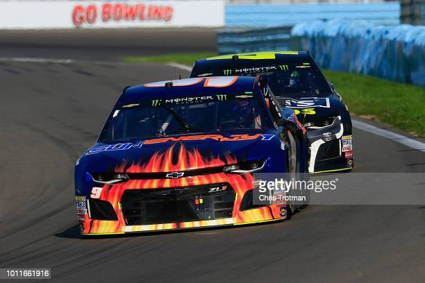 Chase Elliott, driver of the SunEnergy1 Chevrolet, receives a push from teammate Jimmie Johnson, driver of the Lowe's for Pros Chevrolet, after...