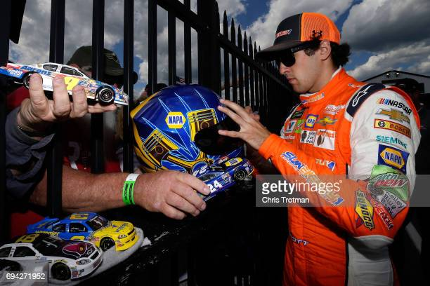 Chase Elliott driver of the SunEnergy1 Chevrolet signs autographs for fans prior to qualifying for the Monster Energy NASCAR Cup Series Axalta...