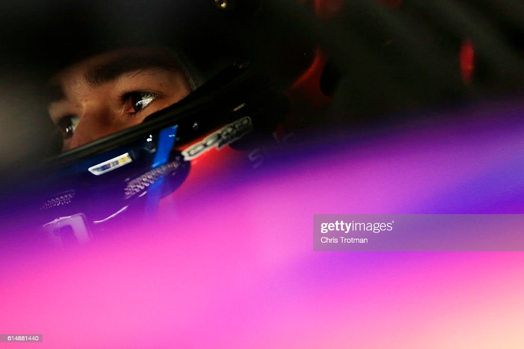 Chase Elliott, driver of the #24 SunEnergy1 Chevrolet, sits in his car during practice for the NASCAR Sprint Cup Series Hollywood Casino 400 at Kansas Speedway on October 15, 2016 in Kansas City, Kansas.