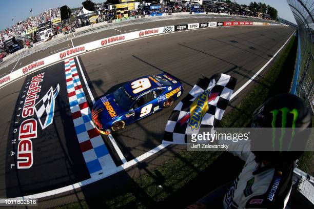 Chase Elliott driver of the SunEnergy1 Chevrolet takes the checkered flag to win during the Monster Energy NASCAR Cup Series GoBowling at The Glen at...