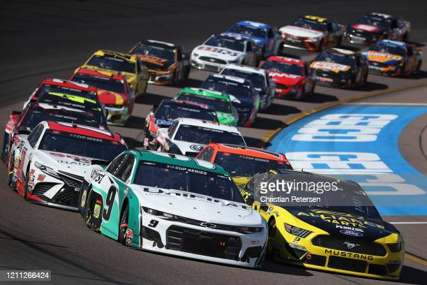 Chase Elliott driver of the UniFirst Chevrolet and Brad Keselowski driver of the Alliance Parts Ford lead at a restart during the NASCAR Cup Series...