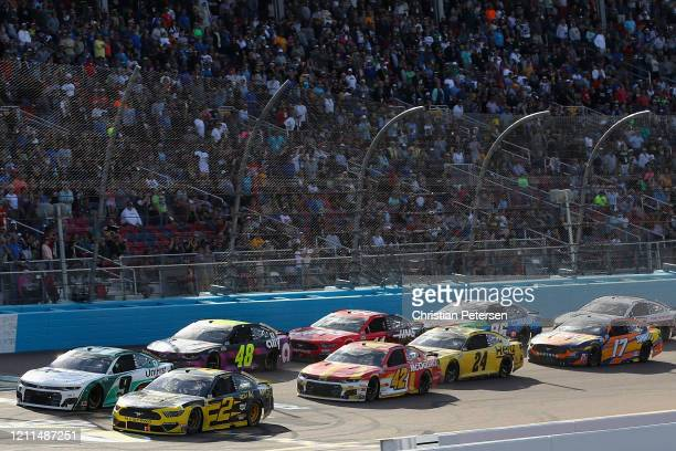 Chase Elliott driver of the UniFirst Chevrolet and Brad Keselowski driver of the Alliance Parts Ford lead during the NASCAR Cup Series FanShield 500...