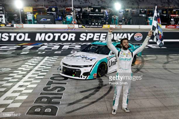 Chase Elliott driver of the UniFirst Chevrolet celebrates after winning the NASCAR Cup Series AllStar Race at Bristol Motor Speedway on July 15 2020...