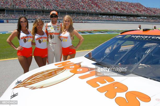 Chase Elliott poses with the Hooters Girls next to his race car prior to the Monster Energy NASCAR Cup Series race on May 7 2017 at Talladega...